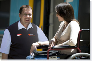 NSW TrainLink staff assisting customer in a wheelchair